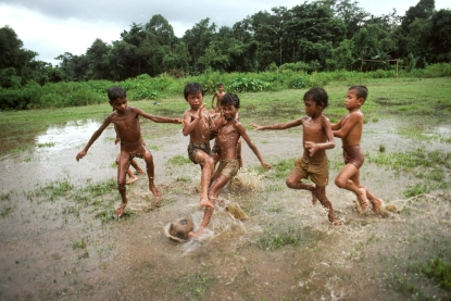 00567_17, Sylhet, Bangladesh, 1983, BANGLADESH-10006NF2. Boys play soccer in the flooded pastures. retouched_Kate Daigneault 09/14/2013